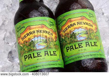 IRVINE, CA - MAY 25, 2014: Two bottles of Sierra Nevada Pale Ale on ice. Sierra Nevada Brewing Co. was established in 1980 by homebrewers in Chico, California,