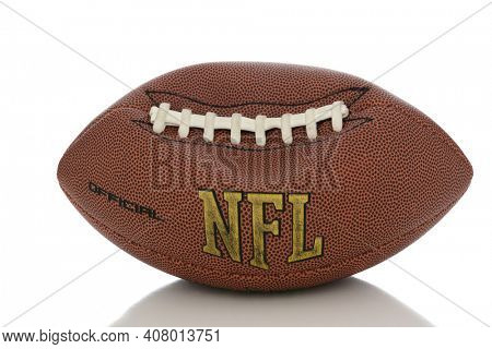 NFL style football partially deflated Isolated on white with reflection..