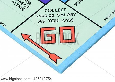 IRVINE, CA - MAY 27, 2014: Monopoly board game closeup of the Go corner. The classic real estate trading game from Parker Brothers was first introduced to America in 1935.