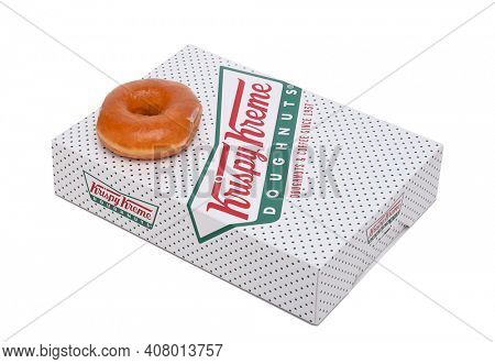 IRVINE, CALIFORNIA - JANUARY 24, 2016:  Krispy Kreme Doughnut Box. Krispy Kreme Doughnuts is a global doughnut company and coffeehouse chain.