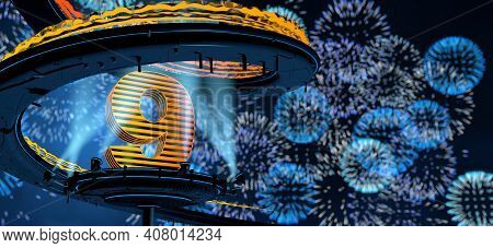 Number 9 Formed By A Yellow Structure On A Round Metal Platform Illuminated By 8 Reflectors Surround