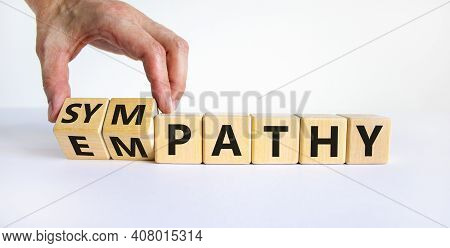 From Empathy To Sympathy. Businessman Turns Cubes And Changes The Word 'empathy' To 'sympathy'. Beau