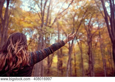 Abundance in forest, Woman with Open Arms, Connected with Nature, Enjoying Life
