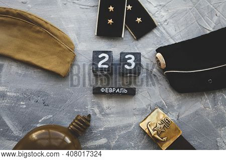 Flask, Cap, Army Belt Depicting A Hammer And Shoulder Straps  Of The War Years And A Wooden Calendar