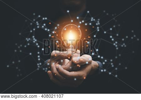 Business Hand Holding Illuminated Light Bulb, Idea, Innovation And Inspiration Concept.concept Of Cr