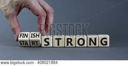 Start And Finish Strong Symbol. Businessman Turns Wooden Cubes, Changes Words 'start Strong' To 'fin