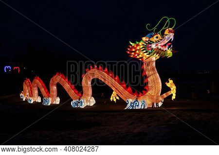 A Huge Bright Glowing Chinese Dragon Lun During The Chinese New Year Celebration. Chinese Lantern Fe