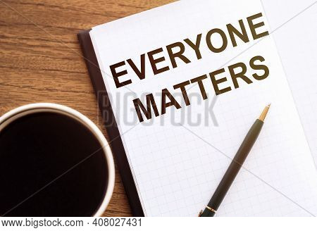 Everyone Matters. Text On Notepad On Wooden Desk.
