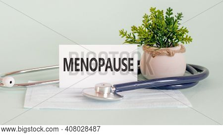On The Card Is The Inscription Menopause, Next To The Tablets.