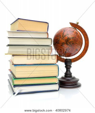 Books And Vintage Globe On White Background