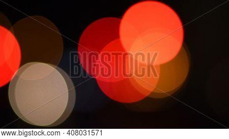 Defocused Circles Of Bokeh Lights In Night Darkness. Blurry Background Of City Traffic Lights. Cinem