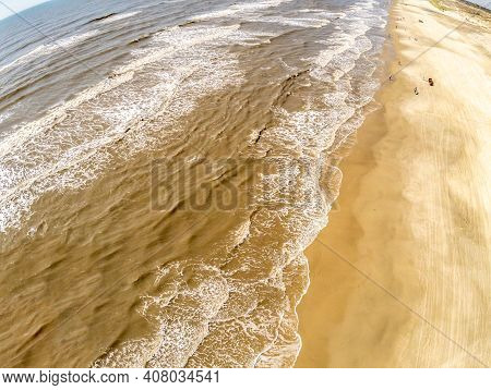 Beach With Sand And Waves