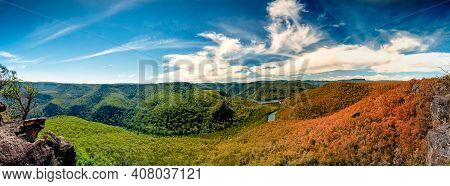 Conceptual Changing Seasons Summer To Fall Panorama Overlooking River Forest And Grasslands