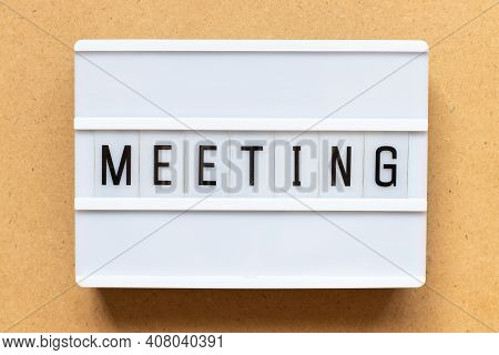 Lightbox With Word Meeting On Wood Background