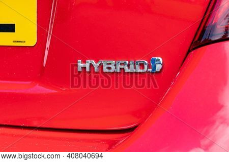 Banchory, Scotland - August 10, 2019: The Hybrid Logo On A Rear Part Of Red Toyota Yaris Hybrid Smal