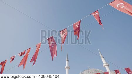 Turkey, Istanbul-december, 2020: Turkish Flags On Blue Sky Background. Action. Festive Ribbon With T