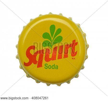 IRVINE, CALIFORNIA - 4 JUNE 2020: Closeup of a Squirt Soda beer bottle cap on white.
