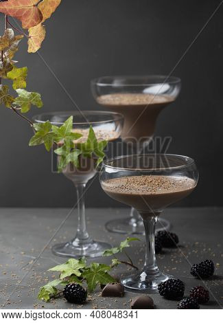 Close Up Of Three Glasses With Chocolate Mousse Dessert On Dark Background With Copy Space. . High Q