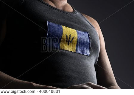The National Flag Of Barbados On The Athletes Chest