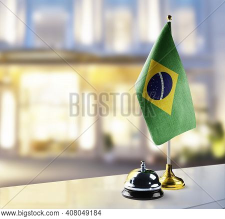 Brazil Flag On The Reception Desk In The Lobby Of The Hotel