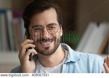 Smiling Caucasian Man Have Pleasant Call On Smartphone