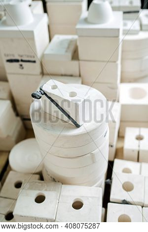 High Angle View On A Stack Of Molds For Casting Tableware Of Different Shape.