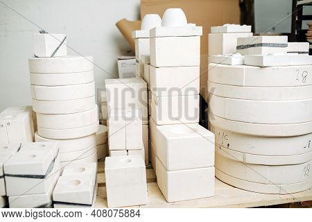 Stack Of Molds For Casting Tableware Of Different Size And Shape.