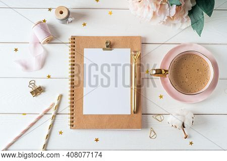Top View Of White Working Table Background With Blank Paper Notebook, Cup Of Coffee. Flat Lay Peonie