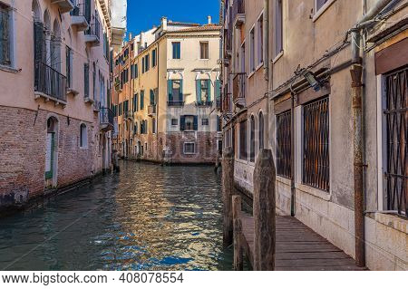 Venice, Italy - September 23, 2019: Venice Canal And Traditional Colorful Venetian Houses View. Clas