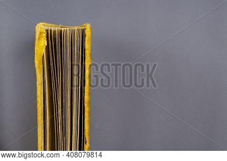 Old Photo Album Wrapped In Yellow Velvet On Gray Background. End End Vintage Yellow Photo Album Vert