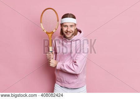 Professional Tennis Player Poses In Ready Position Poses At Play Court Has Happy Expression Wears He