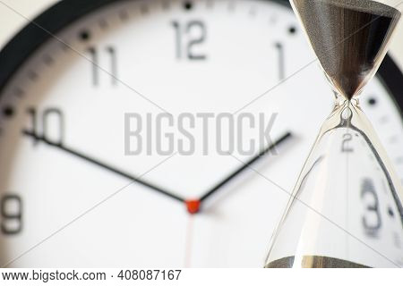 Hour Glass And Clock Concept For Time Missed Important Deadline, Schedule And Deadline.