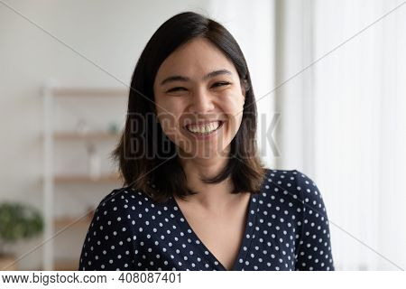 Overjoyed Pretty Asian Woman Look At Camera With Sincere Laughter