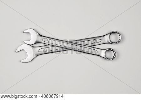 Two Wrenches Or Spanners Crossed On White Backgorund For Concept Design. Repair Service. Service Con