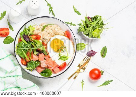 Savory Breakfast. Oatmeal Porrige With Salted Salmon, Egg And Fresh Salad. Top View On White Table W