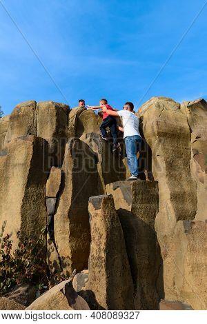 Tourists Climb Up The Basalt Pillars, Tourist Places Of Ukraine, Natural Stone Of The Basalt Rock.ne