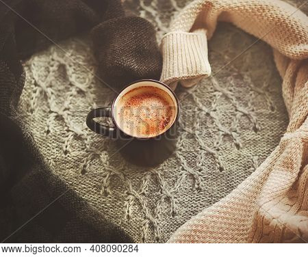 A Black Mug With An Invigorating Aromatic Pleasant Coffee With Cinnamon Stands In The Middle Of A He