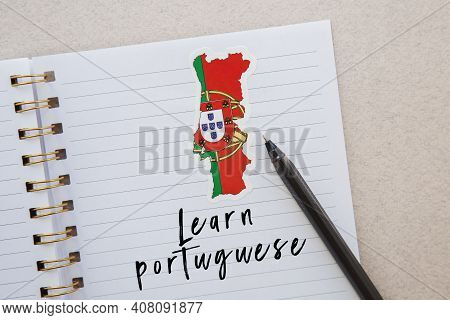 Notepad With The Inscription Learn Portuguese, Portuguese Flag And Country Map, Pen, Foreign Languag