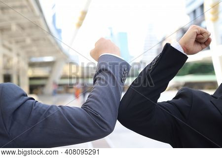 Businessmen Hit Each Other's Elbows Instead Of Greeting Them Because The Virus Is Hurting Many Count