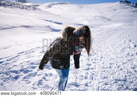 Pretty Woman Covered In Snow On The Mountain From A Snow War.