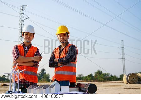 Asian Engineer Manager And Foreman Or Leader Discussion And Pointing To Construction Site Project On