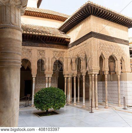The Patio De Los Leones In The Nazaries Palace In The Alhambra In Granada