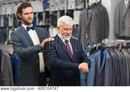 Close Up Of Old Elegant Man In Blue Costume With Tie And White Shirt Fitting Fashionable Costumes. C