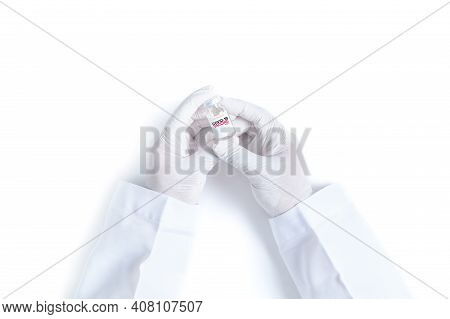 Doctor Or Scientist Hand In White Gloves Holding Covid-19 Vaccine Shot For Diseases Outbreak Vaccina