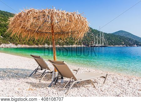 Kefalonia, Greece. Beach Chair And Umbrella At The Antisamos Beach.