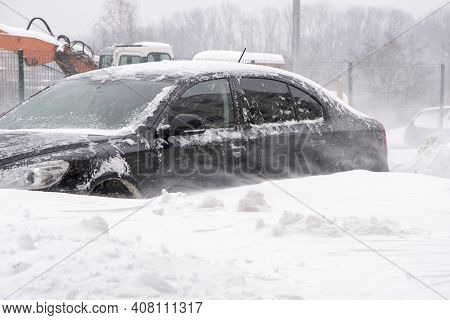 Parked Cars, Covered In Snow, Stand Along The Road. Snowfall In The City, Falling Snowflakes. Concep
