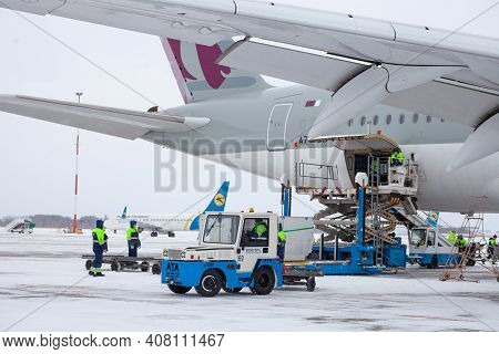 Ukraine, Kyiv - February 12, 2021: Loading Luggage Into The Luggage Compartment Of The Aircraft. Win