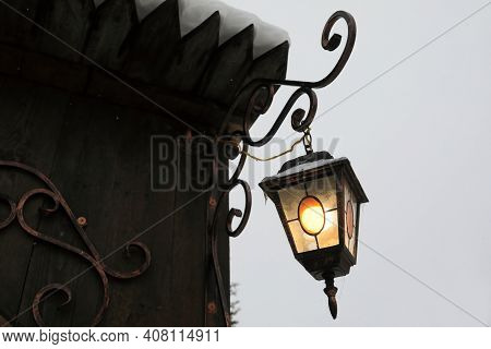 Hanging Vintage Lantern In Winter