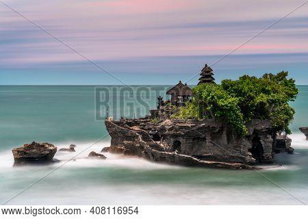 Tahah Lot Ocean Temple In Bali Indonesia Long Exposure During Sunset