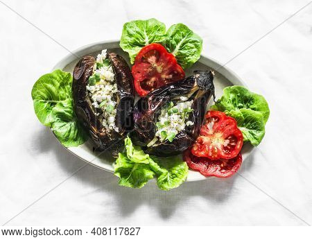 Greek Style Baked Eggplant Stuffed Feta Cheese - Delicious Appetizer, Tapas, Snack On A Light Backgr